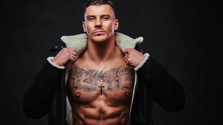 A macho stylish man on a dark background.