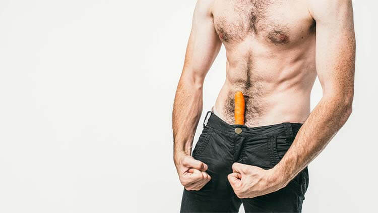 A picture of a man that has a carrot in his pants and showing that he is sexual and powerful. Also he has a good body. Cut view.