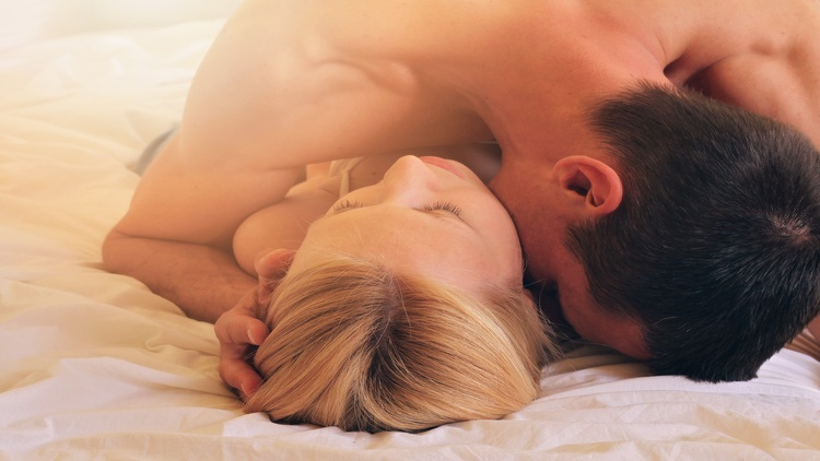 Couple kissing in bed. Love, Sex, Foreplay, Relationship, Tenderness concept