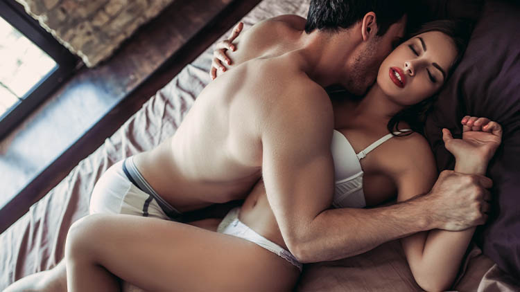 Couple having sex on bed