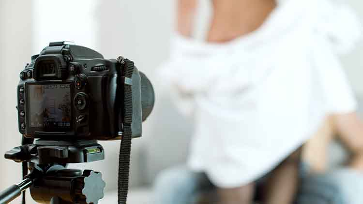 Couple recording home video with dslr camera.