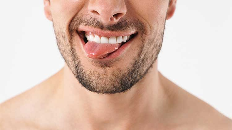 Cropped photo closeup of funny naked man grimacing at camera with sticking out his tongue