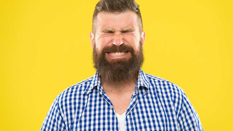 Just sneezed. Man bearded hipster with sneezing face closed eyes close up yellow background