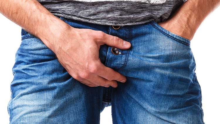 Male hand on groin