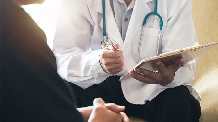 Men's health exam with patient having consultation with doctor