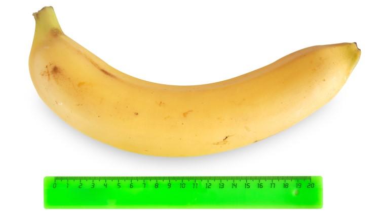 Banana next to green ruler
