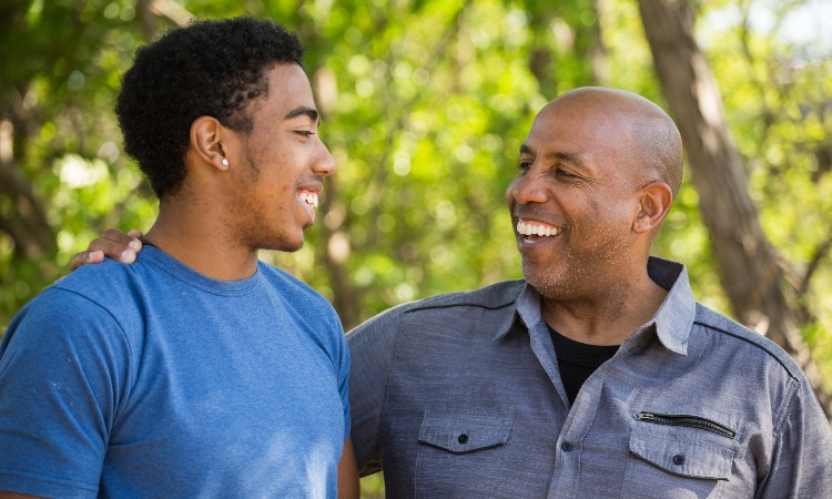 Father talking and spending time with son outdoors