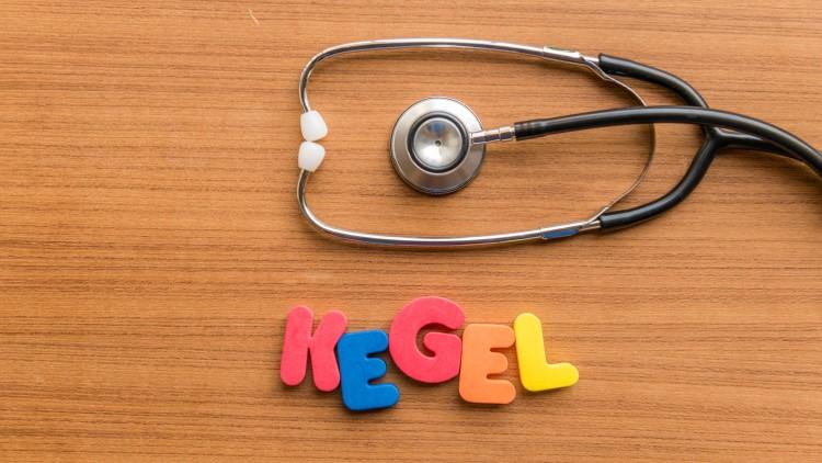 Kegel spelled with fridge magnet letters next to stethoscope