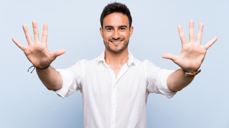 Man isolated on blue background holding all fingers to camera
