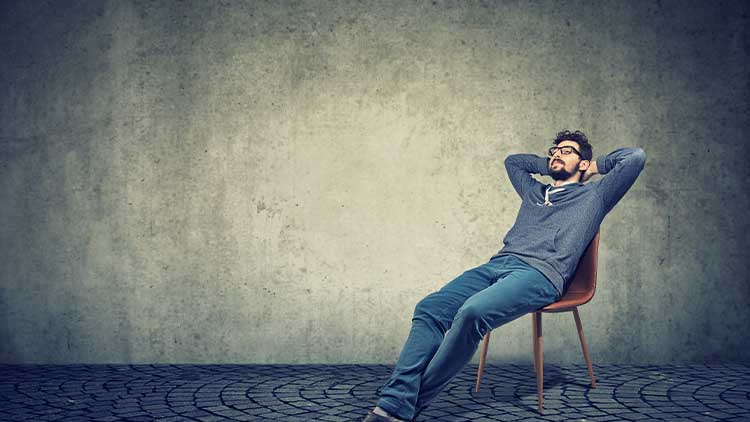 man sitting on chair and daydreaming