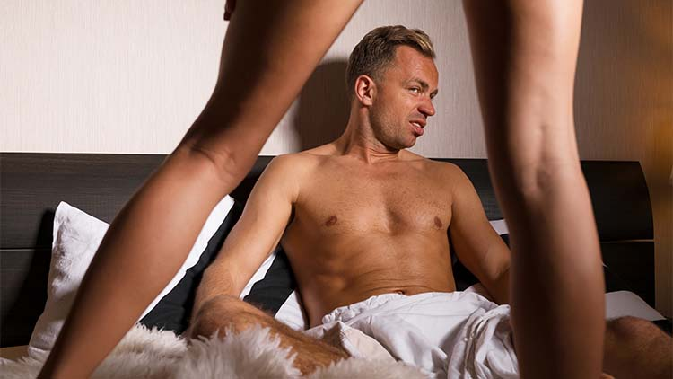 A man unable to get aroused by his woman whilst they are both spending some time in their double bed