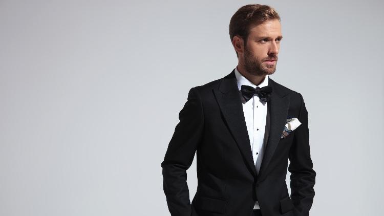 Serious looking man in tuxedo