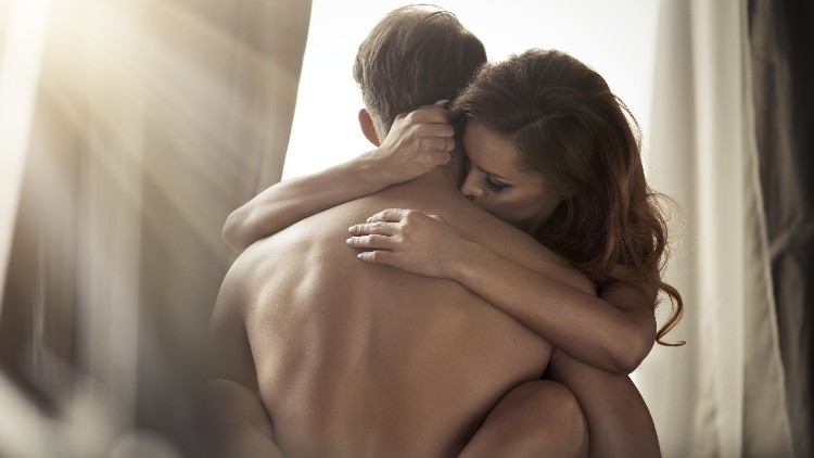 Young couple intimately touching naked