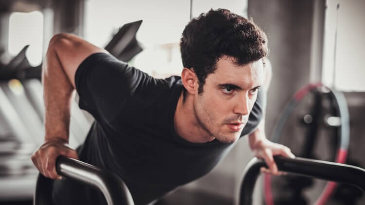 Young man exercising leaning forward